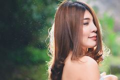 Portrait of beautiful Asian woman enjoy natural outdoor at fores Royalty Free Stock Images