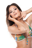 Portrait of beautiful Asian woman in green bikini. Sexy posing isolated over white background Royalty Free Stock Image