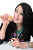 Portrait of beautiful asian woman model is holding cosmetic cont Stock Photos