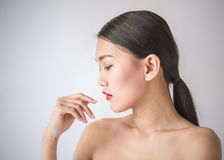 Portrait of beautiful asian woman over gray background stock photography