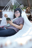 Portrait of beautiful asian woman relaxing time reading book on Royalty Free Stock Photos