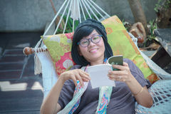 Portrait of beautiful asian woman relaxing time reading book on Royalty Free Stock Photo
