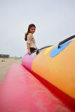 Portrait Beautiful asian woman. Sit on banana boat in the sea beach , Thai girl Royalty Free Stock Photography