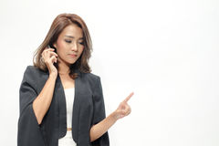 Portrait beautiful asian woman standing , Hold the phone ,showing blank area for sign or copyspace royalty free stock photo