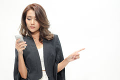 Portrait beautiful asian woman standing , Hold the phone ,showing blank area for sign or copyspace stock photo