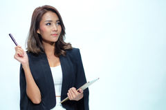 Portrait beautiful asian woman standing, Hold tablet and pen stock photo
