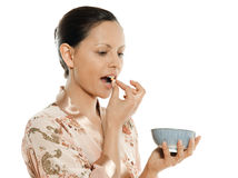 Portrait of beautiful Asian woman taking pill stock images