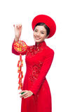 Portrait of a beautiful Asian woman on traditional festival cost. Ume Ao Dai. Tet holiday. Lunar New Year. Text mean Happiness stock images