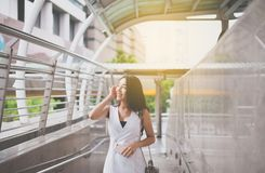 Portrait beautiful asian woman walking in the center city,Happy and smiling,Female with positive attitude expressing energy in goo. D time royalty free stock photos