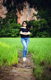 Portrait a beautiful asian woman wearing glasses at cornfield in the morning Stock Photography