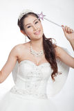 Portrait beautiful asian woman in white wedding dress with fairy scepter with angel wings Royalty Free Stock Photo