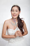Portrait beautiful asian woman in white wedding dress with fairy scepter with angel wings Stock Photography