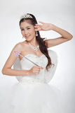 Portrait beautiful asian woman in white wedding dress with fairy scepter with angel wings Royalty Free Stock Image
