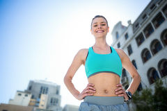 Portrait of a beautiful athlete with her hands on her hips Royalty Free Stock Images