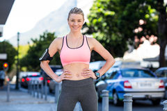 Portrait of a beautiful athlete with her hands on her hips Stock Photos