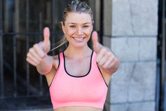 Portrait of a beautiful athlete with thumbs up Royalty Free Stock Photos