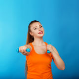 Portrait of a beautiful athletic girl with dumbbells Stock Photography