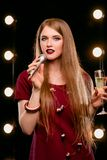 Portrait of beautiful attractive smiling blonde woman singing in microphone in karaoke Stock Photo