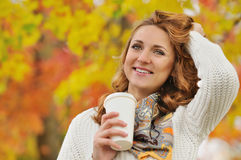 Portrait of beautiful attractive stylish young woman with cup of Stock Photography
