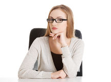 Portrait of beautiful attractive woman in eyeglasses. She's sitt royalty free stock photography