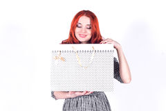 Portrait of a beautiful, attractive woman with gift bags in her hands Stock Images