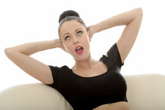 Portrait Of A Beautiful Attractive Young Caucasian Woman Relaxing And Posing On A Sofa Or Couch stock photos