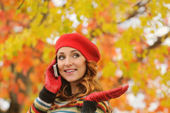Portrait of beautiful attractive young woman in red beret talkin Stock Images