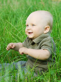 Portrait of beautiful baby boy on a grass Stock Photo