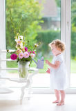 Portrait of a beautiful baby girl with fresh flowers Royalty Free Stock Photography