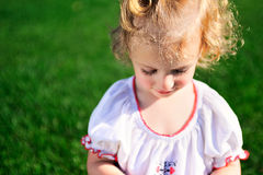 Portrait of beautiful baby girl on the lawn Stock Images