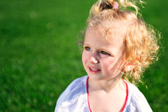 Portrait of beautiful baby girl on the lawn Stock Photo