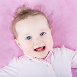 Portrait of a beautiful baby girl on pink background Stock Photo