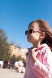Portrait of beautiful baby girl walking on the street Stock Photos