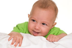 Portrait of a beautiful baby in green Stock Images