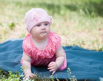Portrait of beautiful baby on the lawn Royalty Free Stock Photography