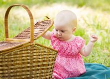 Portrait of beautiful baby on the lawn Stock Image