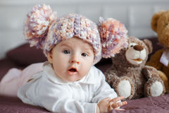 Portrait of a beautiful baby with plush toys