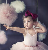 Portrait of a beautiful baby wearing a red ribbon Stock Photo