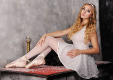 Portrait of beautiful ballerina which posing against dark backgr Royalty Free Stock Image