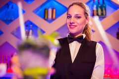 Portrait of beautiful barmaid standing Royalty Free Stock Photo