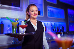Portrait of beautiful bartender holding serving tray Royalty Free Stock Photo