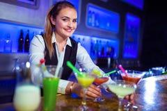 Portrait of beautiful bartender standing Stock Photos