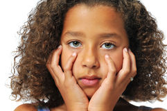 Portrait of beautiful biracial girl. With hands on her face stock photography