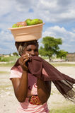 Portrait of beautiful black African women with fruits on her head, Botswana. Portrait of beautiful black African women walking with headscarf and fruits on her royalty free stock photography