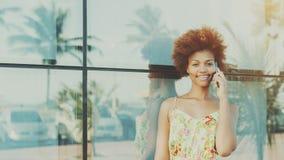 Portrait of beautiful black brazilian girl speaking on the phone Stock Photo