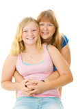 Beautiful Blond Mother and Teenage Daughter. Portrait of a beautiful blond, blue eyed mother and teenage daughter.  Isolated on white Stock Image