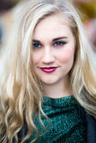 Portrait of a Beautiful Blond Blue Eyed Teenage Girl in Green To. Portrait of a beautiful blue eyed blond teenage girl with long hair, dark red lipstick, green Stock Photos