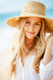 Portrait of beautiful blond girl on the beach Stock Photography