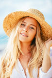 Portrait of beautiful blond girl on the beach Stock Photo