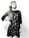 Portrait of the beautiful blond girl in black dress Royalty Free Stock Photos